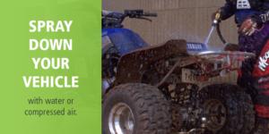 "recreational ATV rider sprays down blue ATV with PlayCleanGo message: ""spray down your vehicle"""