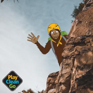 Steward bigfoot wearing helmet and climbing on red rocks